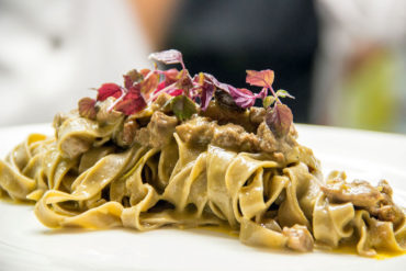 Barolo wine homemade fettuccine with wild boar white ragout.