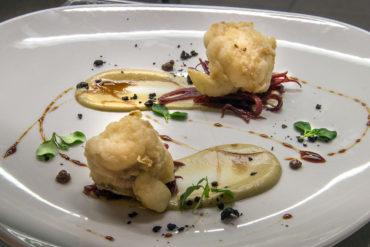 Rana pescatrice, crema di carciofi, cipolla caramellata e gel di olive.